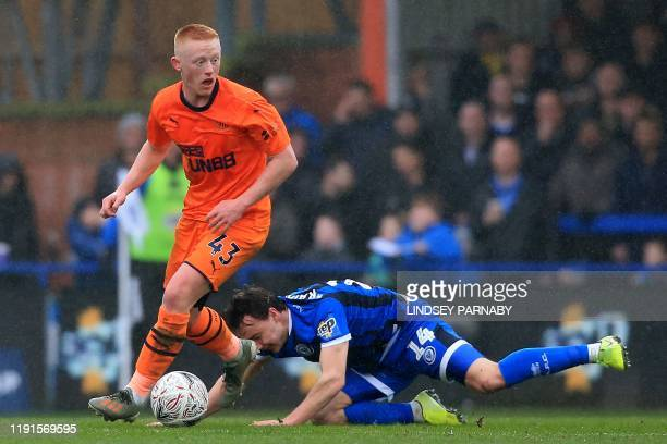 Newcastle United's English midfielder Matthew Longstaff vies with Rochdale's English midfielder Oliver Rathbone during the English FA Cup third round...