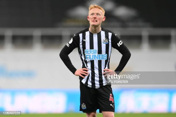 Newcastle United's English midfielder Matty Longstaff gestures on the pitch after the English Premier League football match between Newcastle United...