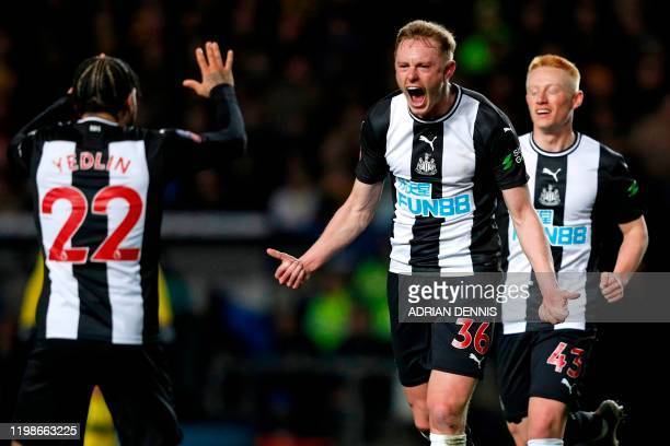 Newcastle United's English midfielder Sean Longstaff celebrates with teammates after scoring the opening goal of the FA Cup fourth round replay...