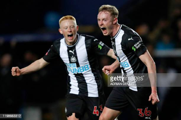Newcastle United's English midfielder Sean Longstaff celebrates with his brother Newcastle United's English midfielder Matthew Longstaff after...
