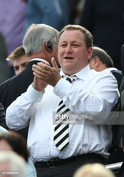 Newcastle United's English owner Mike Ashley applauds as he waits for the kick off in the English Premier League football match between Newcastle...