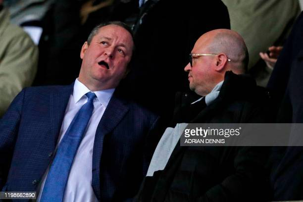 Newcastle United's English owner Mike Ashley chats with director Lee Charnley in the crowd ahead of the FA Cup fourth round replay football match...