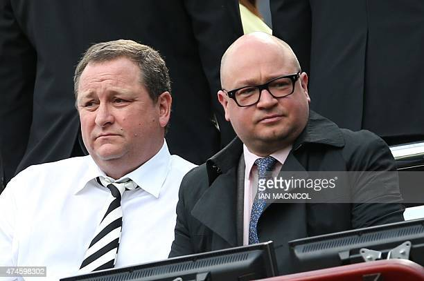 Newcastle United's English owner Mike Ashley sits with managing director Lee Charnley as he waits for the kick off in the English Premier League...