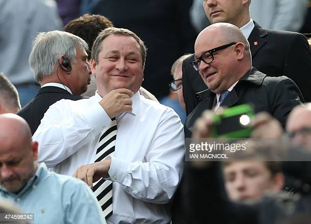 Newcastle United's English owner Mike Ashley smiles with managing director Lee Charnley as he waits for the kick off in the English Premier League...