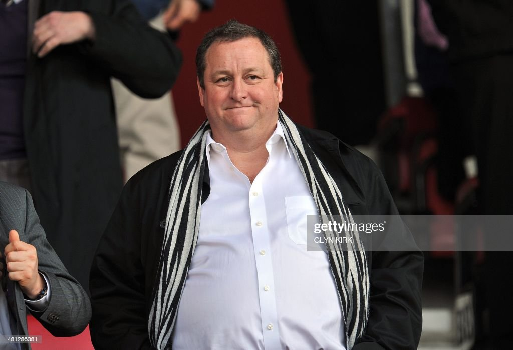 Newcastle United's English owner Mike Ashley takes his seat before the English Premier League football match between Southampton and Newcastle United at St Mary's Stadium in Southampton, southern England on March 29, 2014. AFP PHOTO / GLYN KIRK USE. No use with unauthorized audio, video, data, fixture lists, club/league logos or live services. Online in-match use limited to 45 images, no video emulation. No use in betting, games or single club/league/player publications. /