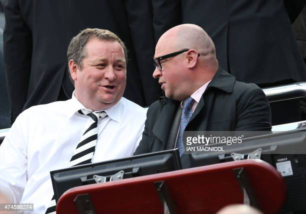 Newcastle United's English owner Mike Ashley talks with managing director Lee Charnley as he waits for the kick off in the English Premier League...