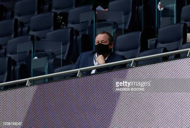 Newcastle United's English owner Mike Ashley watches from the stands during the English Premier League football match between Tottenham Hotspur and...