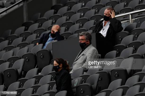 Newcastle United's English owner Mike Ashley watches his side lose the English Premier League football match between Newcastle United and Brighton...
