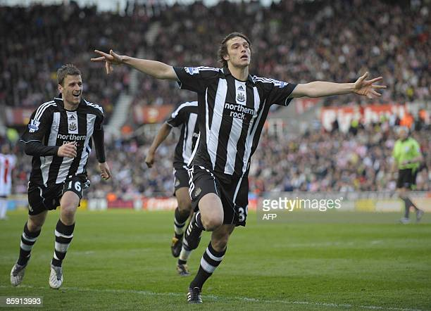Newcastle United's English striker Andy Carroll celebrates scoring his side's equalizing goal during the English Premier League football match...