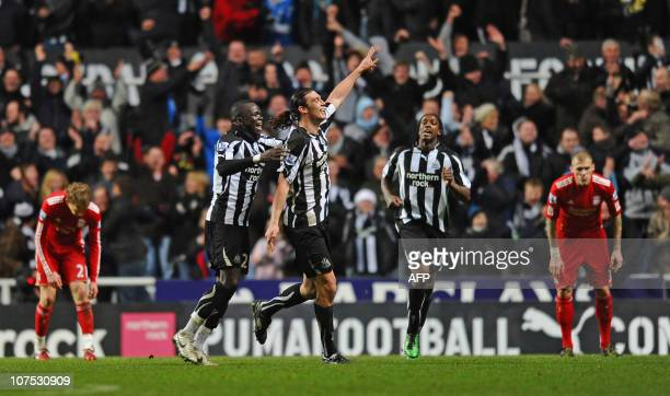 Newcastle United's English striker Andy Carroll celebrates scoring their third goal during the English Premier League football match between...