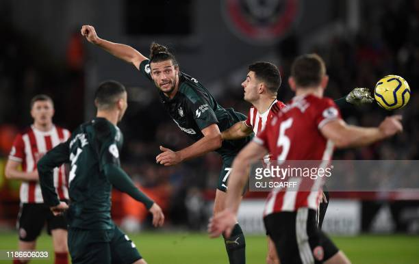 Newcastle United's English striker Andy Carroll headers the balll during the English Premier League football match between Sheffield United and...