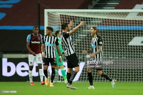 Newcastle United's English striker Andy Carroll reacts after Newcastle United's Irish midfielder Jeff Hendrick scored their second goal during the...
