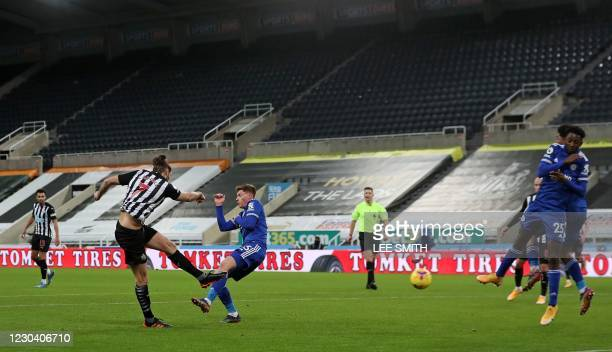 Newcastle United's English striker Andy Carroll shoots to score a goal past Leicester City's English midfielder Harvey Barnes during the English...