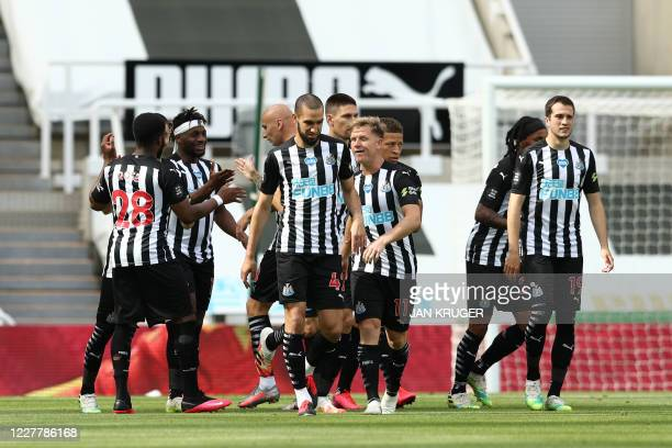 Newcastle United's English striker Dwight Gayle celebrates with teammates after scoring a goal during the English Premier League football match...