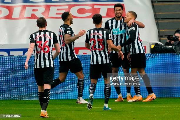 Newcastle United's English striker Dwight Gayle celebrates with teammates after scoring their second goal during the English Premier League football...