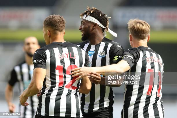 Newcastle United's English striker Dwight Gayle celebrates with Newcastle United's Scottish midfielder Matt Ritchie and Newcastle United's French...