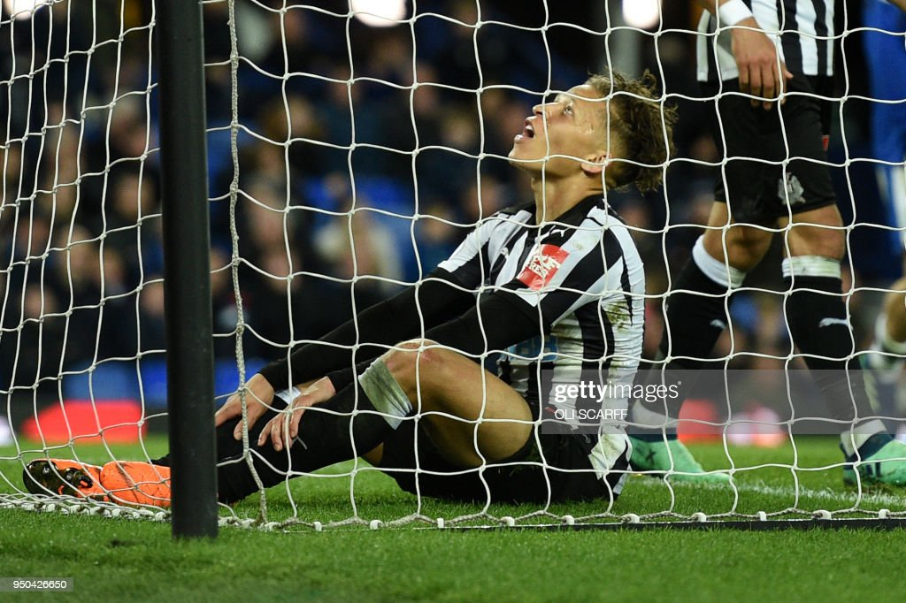 Newcastle United's English striker Dwight Gayle reacts after failing to score during the English Premier League football match between Everton and Newcastle United at Goodison Park in Liverpool, north west England on April 23, 2018. (Photo by Oli SCARFF / AFP) / RESTRICTED TO EDITORIAL USE. No use with unauthorized audio, video, data, fixture lists, club/league logos or 'live' services. Online in-match use limited to 75 images, no video emulation. No use in betting, games or single club/league/player publications. /