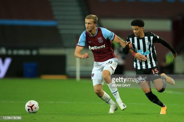 Newcastle United's English-born Northern Irish defender Jamal Lewis vies for the ball against West Ham United's Czech midfielder Tomas Soucek during...