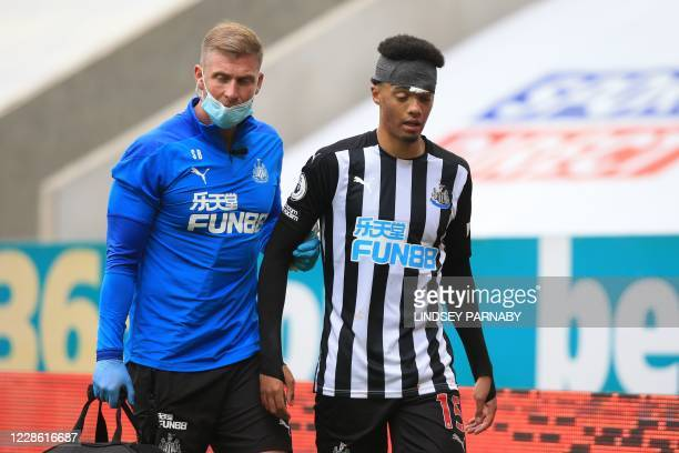 Newcastle United's English-born Northern Irish defender Jamal Lewis receives medical attention during the English Premier League football match...
