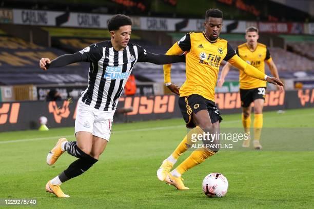 Newcastle United's English-born Northern Irish defender Jamal Lewis vies with Wolverhampton Wanderers' Portuguese defender Nelson Semedo during the...
