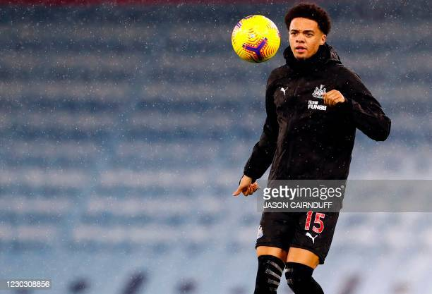 Newcastle United's English-born Northern Irish defender Jamal Lewis warms up for the English Premier League football match between Manchester City...
