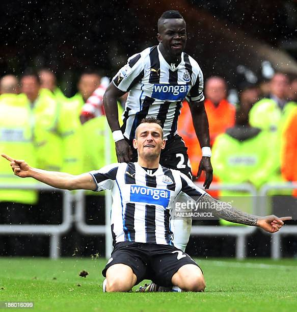 Newcastle United's French defender Mathieu Debuchy and Newcastle United's Ivorian midfielder Cheick Tiote celebrate Debuchy's equaliser during the...