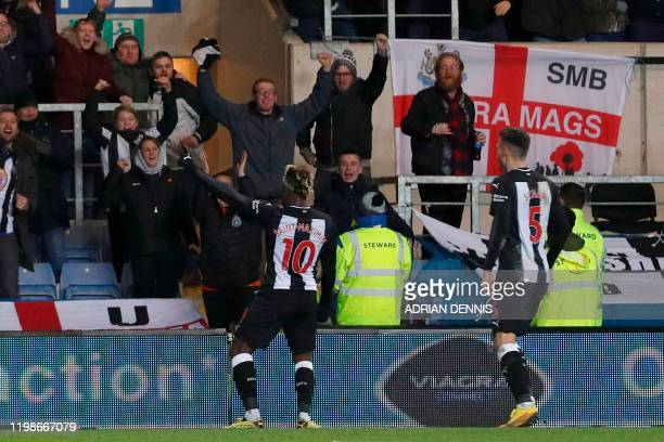Newcastle United's French midfielder Allan SaintMaximin celebrates after scoring their third goal during the FA Cup fourth round replay football...