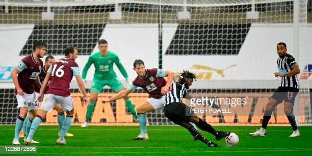Newcastle United's French midfielder Allan Saint-Maximin shoots to score the opening goal during the English Premier League football match between...
