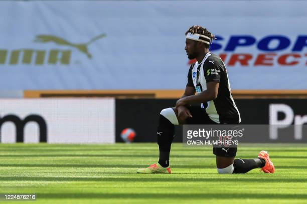 Newcastle United's French midfielder Allan SaintMaximin takes a knee to protest against racism and show solidarity with the Black Lives Matter...