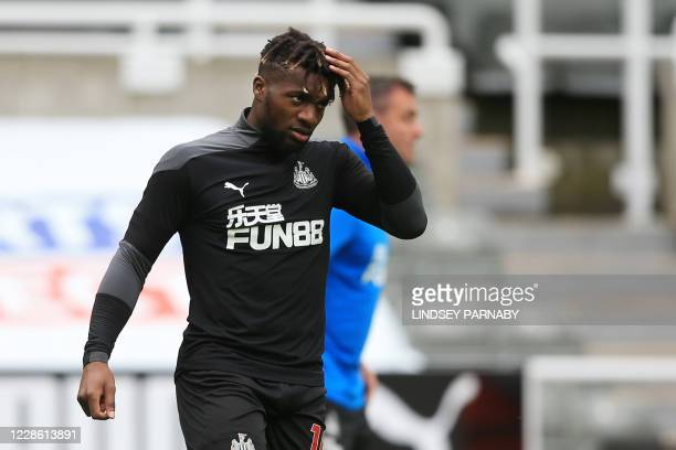 Newcastle United's French midfielder Allan Saint-Maximin warms up before the English Premier League football match between Newcastle United and...