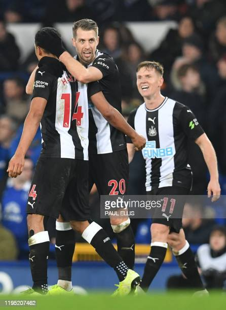 Newcastle United's French midfielder Florian Lejeune celebrates scoring their second late goal to equalise 22 during the English Premier League...