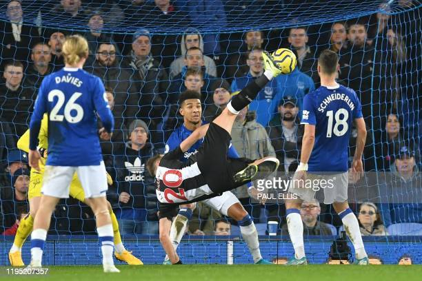 Newcastle United's French midfielder Florian Lejeune scores their first goal during the English Premier League football match between Everton and...