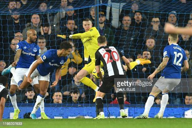 Newcastle United's French midfielder Florian Lejeune scores their second late goal in a goalmouth scramble to equalise 22 during the English Premier...