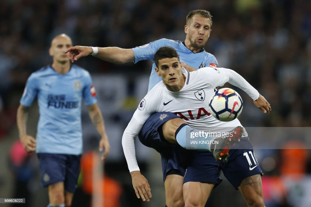 Newcastle United's French midfielder Florian Lejeune (L) vies with Tottenham Hotspur's Argentinian midfielder Erik Lamela during the English Premier League football match between Tottenham Hotspur and Newcastle United at Wembley Stadium in London, on May 9, 2018. (Photo by Ian KINGTON / AFP) / RESTRICTED TO EDITORIAL USE. No use with unauthorized audio, video, data, fixture lists, club/league logos or 'live' services. Online in-match use limited to 75 images, no video emulation. No use in betting, games or single club/league/player publications. /