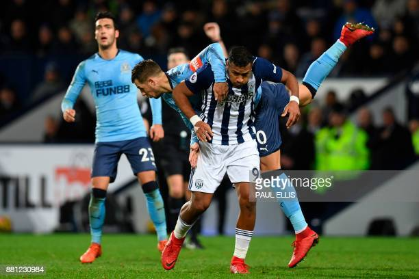 Newcastle United's French midfiielder Florian Lejeune jumps over the top of West Bromwich Albion's Venezuelan striker Salomon Rondon during the...