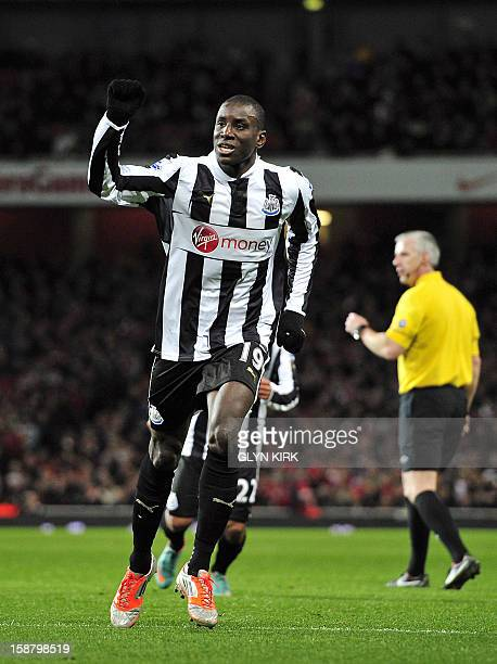 Newcastle United's French-born Senegalese striker Demba Ba celebrates scoring their first goal from a free-kick during the English Premier League...