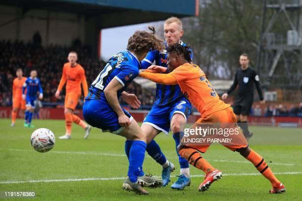 Newcastle United's Ghanaian midfielder Christian Atsu vies with Rochdale's English defender Luke Matheson and Rochdale's Northern Irish midfielder...