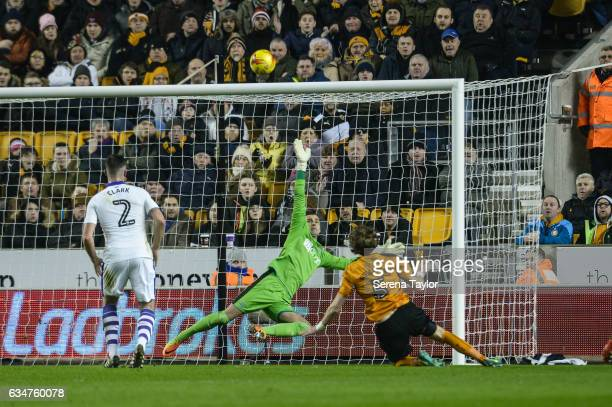 Newcastle United's Goalkeeper Karl Darlow dives in the air in attempt to deflect a shot by Richard Stearman of Wolverhampton Wanderers during the Sky...