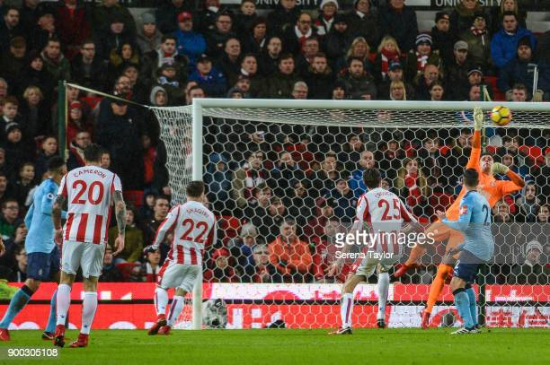 Newcastle United's Goalkeeper Karl Darlow dives in the air to put the ball over the crossbar during the Premier League match between Stoke City and...