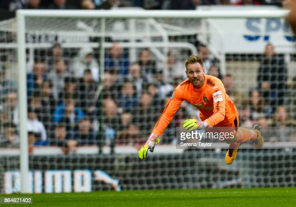 Newcastle United's Goalkeeper Rob Elliot fly's through the air after heading the ball clear during the Premier League match between Newcastle United...