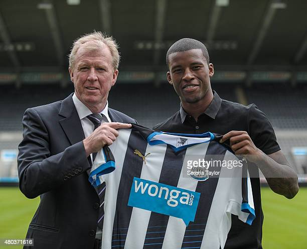 Newcastle United's Head Coach Steve McClaren stands holding a Newcastle Shirt on the pitch with New Summer signing Georginio Wijnaldum at a Newcastle...