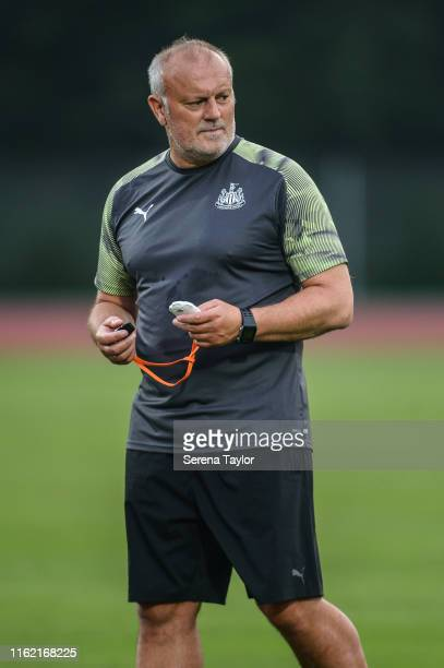 Newcastle United's Head of Under 23's Coach Neil Redfearn holds a stop watch during the Newcastle United Training session at Nanjing Olympic Sports...