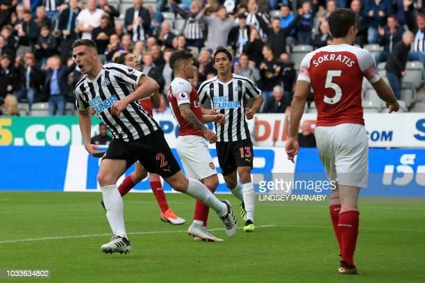 Newcastle United's Irish defender Ciaran Clark celebrates scoring his team's first goal during the English Premier League football match between...