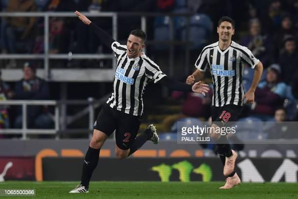 Newcastle United's Irish defender Ciaran Clark celebrates scoring his team's second goal with Newcastle United's Argentinian defender Federico...