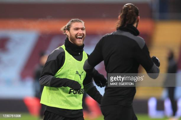 Newcastle United's Irish midfielder Jeff Hendrick warms up with Newcastle United's English striker Andy Carroll ahead of the English Premier League...