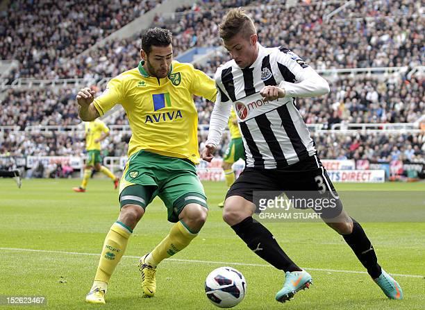 Newcastle United's Italian defender Davide Santon vies with Norwich City's English midfielder Bradley Johnson during the English Premier League...