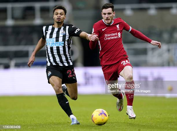 Newcastle United's Jacob Murphy and Liverpool's Andrew Robertson battle for the ball during the Premier League match at St James' Park, Newcastle.