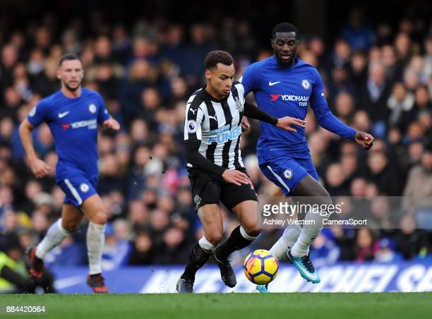 Newcastle United's Jacob Murphy holds off the challenge from Chelsea's Tiemoue Bakayoko during the Premier League match between Chelsea and Newcastle...