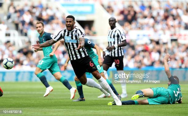 Newcastle United's Jamaal Lascelles reacts after a challenge from Tottenham Hotspur's Ben Davies during the Premier League match at St James' Park...