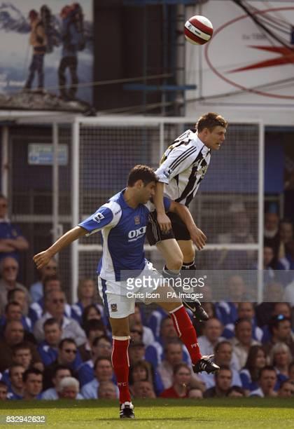Newcastle United's James Milner and Portsmouth's Dejan Stefanovic battle for the ball.